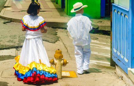 View on children dressed with traditional colombian costume in Salento, Colombia