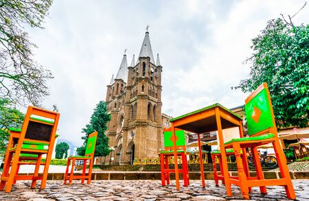 Church and main square in colonial city El Jardin, Colombia, South America