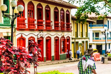 Colorful red colonial buildings at central square of village Jerico in Colombia