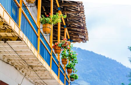 View on colorful balcony in front of colonial buildings of Jardin, Colombia Stock Photo