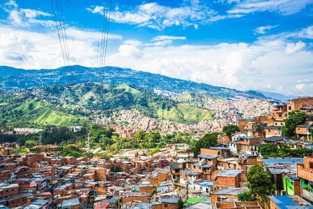 view over buildings and valley of Comuna 13 in Medellin, Colombia
