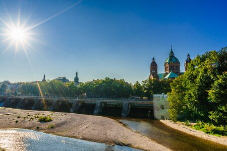 View on Isar and Sankt Lukas church in Munich. Bavaria, Germany