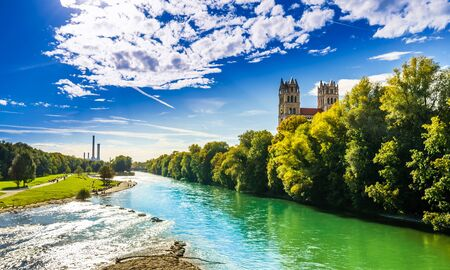 View on summer landscape by St. Maximilian church and Isar in Munich