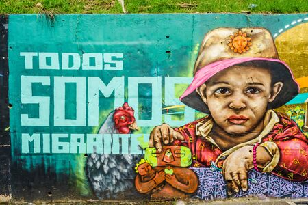 Street art graffiti on a wall in the street of Medellin, Colombia - March 16, 2019 新闻类图片