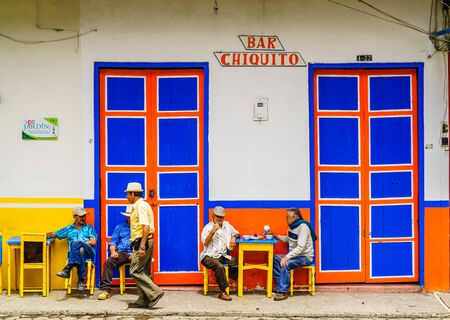 El Jardin, Colombia - March 27, 2019 - View on people sitting in front of a bar in the center of the town