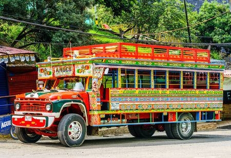Andes, COLOMBIA - 27th March 2019. Colorful traditional rural bus in Colombia called chiva