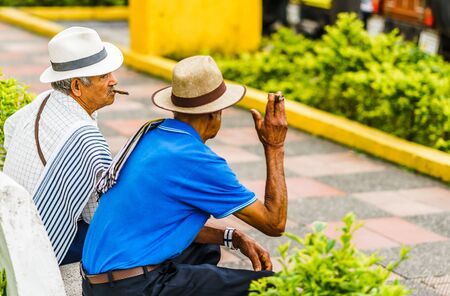 Salento, COLOMBIA, MARCH 23 2019: View on senior traditional colombian men park in Medellin, Colombia 2019 新闻类图片