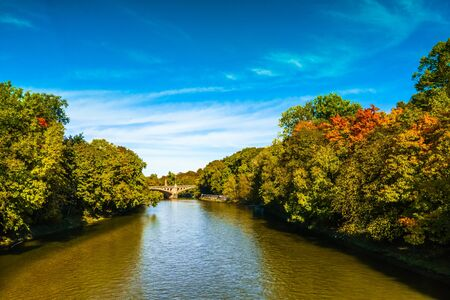 View on colorful trees n Autumn at the Isar in Munich