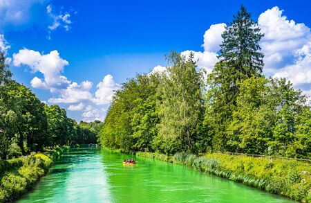 View on people doing rafting on the Isar River, Munich