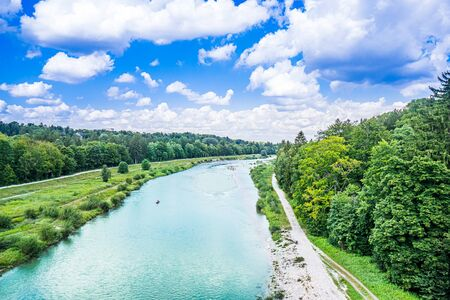 summer view of green Isar river in Munich, Germany