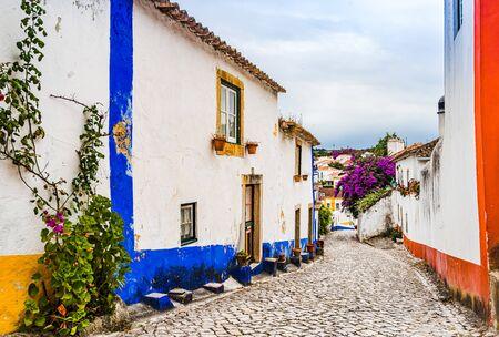 Narrow White Blue Street in Mediieval City Obidos Portugal