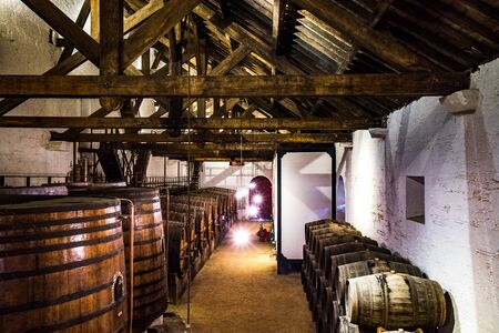 Wine cellar used to age Port wine in Port, Portugal 免版税图像