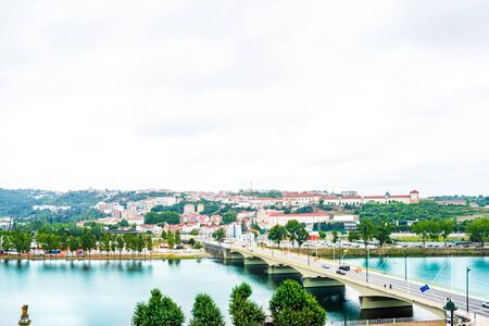 View of the central area, Mondego River and Santa Clara Bridge, Portugal 免版税图像 - 142154171