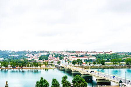 View of the central area, Mondego River and Santa Clara Bridge of Coimbra, Portugal 免版税图像 - 142709898