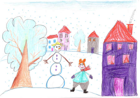 Happy child playing near a snowman in winter.Child drawing
