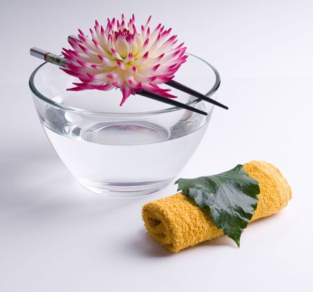 pink flower floating on the Chinese sticks in bowl spa background