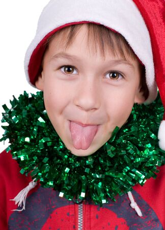 cute small boy with santas hat puts out the tongue isolated Stock Photo