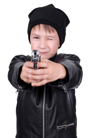 young boy pointing gun, focus on boys face, isolated Stock Photo