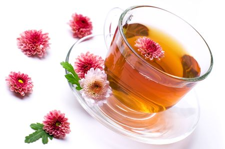 cup of herbal tea with flowers on white