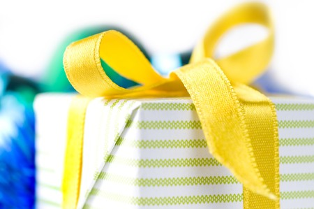 beautiful gift box with yellow ribbon over white background