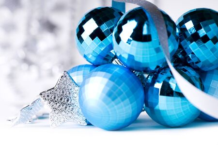 Blue Christmas baubles with silver decoration, isolated Stock Photo