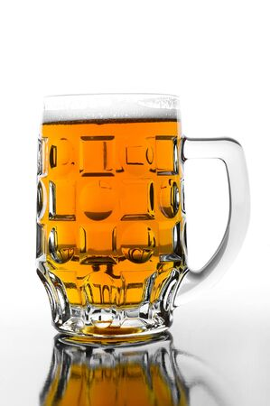 Cold  beer in glass on glossy background photo