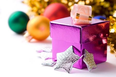 beautiful magenta gift box on christmas background isolated