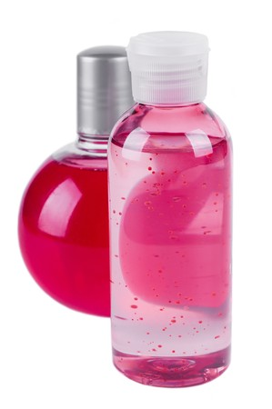 massage oil bottle and foam for bath Stock Photo