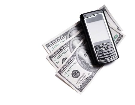 Mobile phone and dollars isolated Stock Photo