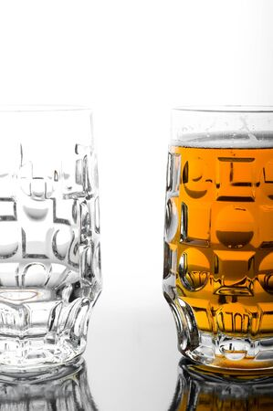Beer glasses. One empty second full. photo