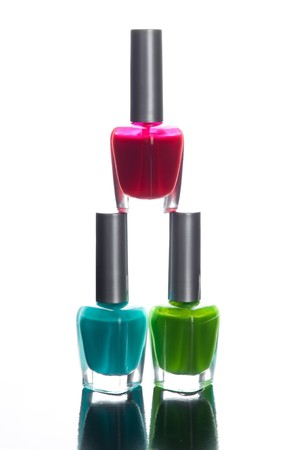 Nail polish bottles on glossy background