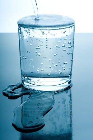 overflowed glass of water Stock Photo