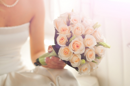 wedding bouquet at brides hands photo