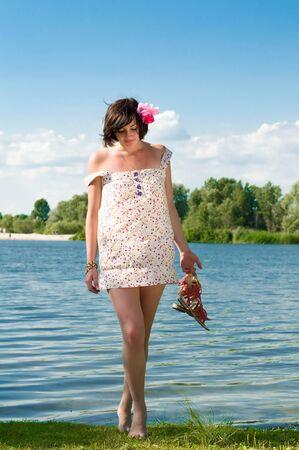 beautiful girl on river bank Stock Photo - 8261565