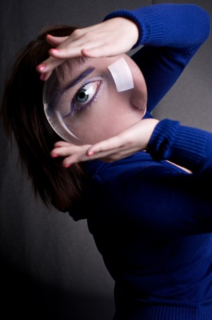 beautiful girl with big magnifying glass in hands Stock Photo