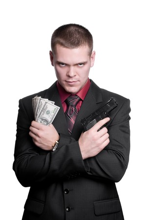 Businessman with gun and money. Isolated on white photo