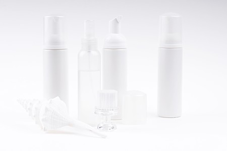 cosmetic bottles with brush and shell