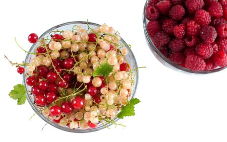 Fresh Raspberry and currant isolated on white background