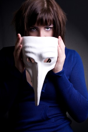 girl with white mask in hands Stock Photo