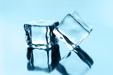 ice cubes on black glossy background Stock Photo