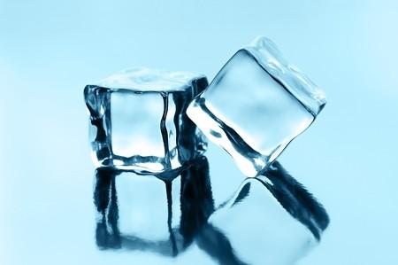 ice cubes on black glossy background Stock Photo
