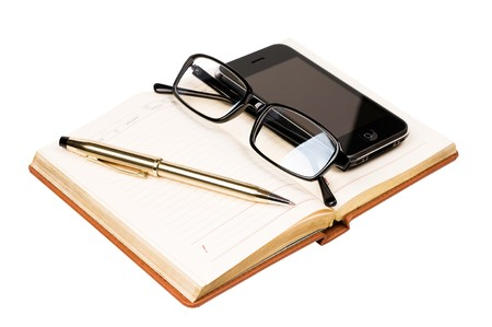 organizer, mobile phone and glasses isolated
