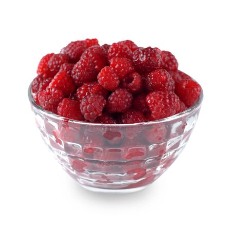 ripe raspberry in a dish isolated on white background Stock Photo