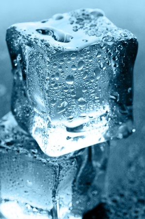 wet ice cubes on black glossy background photo