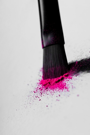 Make-up brush with colorful crushed eyeshadows