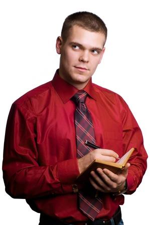 Businessman with  organizer in hands photo