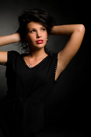 art fashion photo of portrait young woman on dark background Stock Photo - 9869245