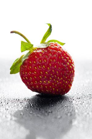 red strawberry with water drops over black Stock Photo - 9862802