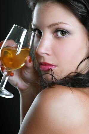 Beautiful girl with wine glass on black Stock Photo - 10327453
