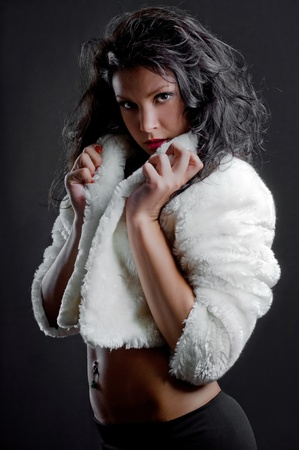 beautiful sexy girl in fur coat Stock Photo
